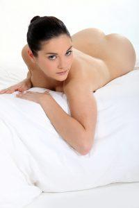 A Beautiful Woman Lying on a Bed