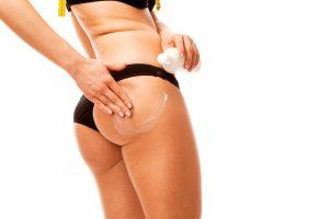 A Woman Applying the Cellulite Hot Cream on Her Butt