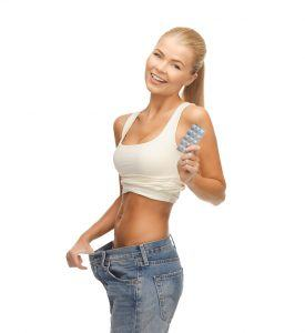 woman showing big pants and pack of pills