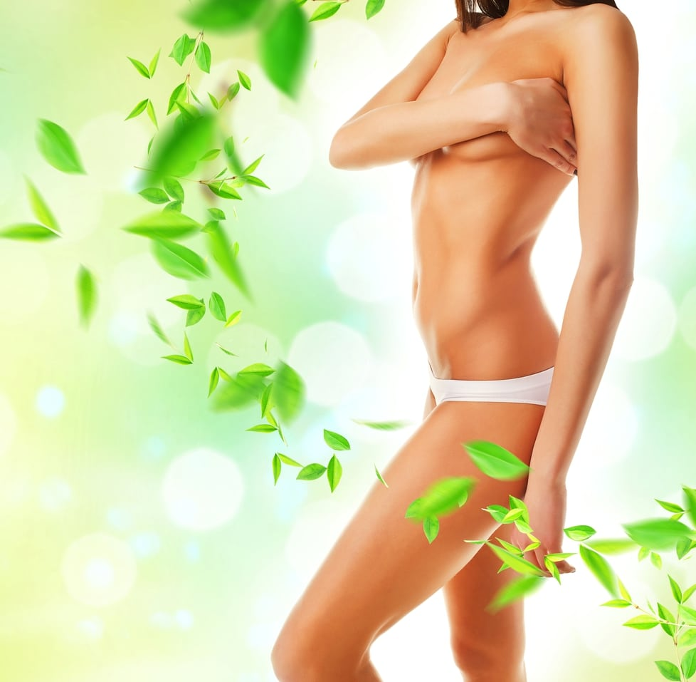 A beautiful woman and green leaves