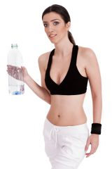fitness women holding a water bottle on a white isolated background