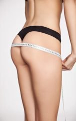 woman measuring her shape