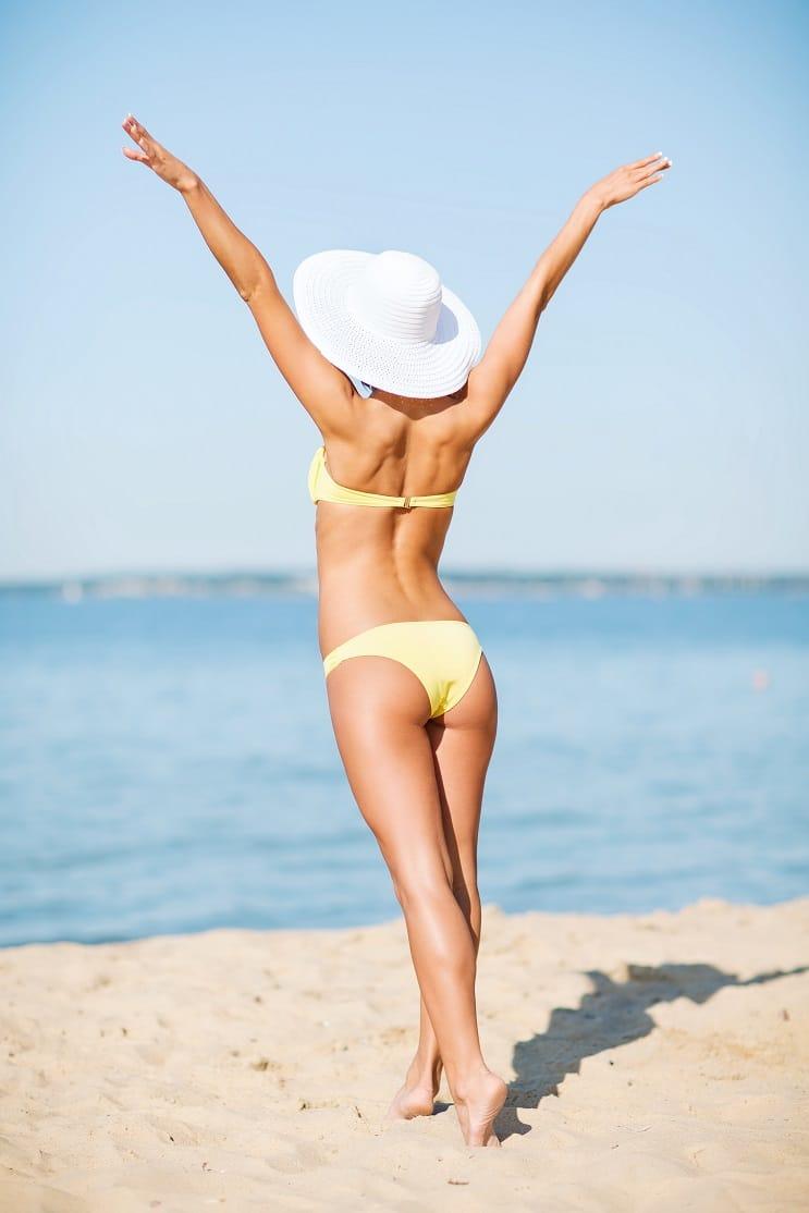summer holidays, vacation and the beach - girl in bikini posing on the beach