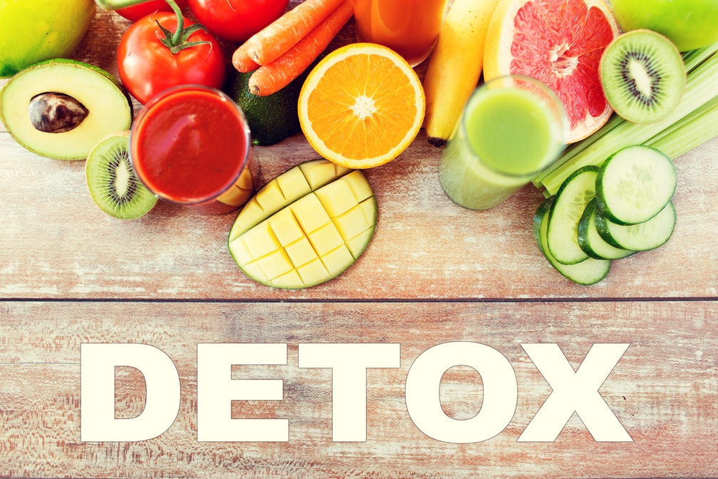 detox, healthy eating, food and diet concept - close up of fresh juice glass and fruits on table