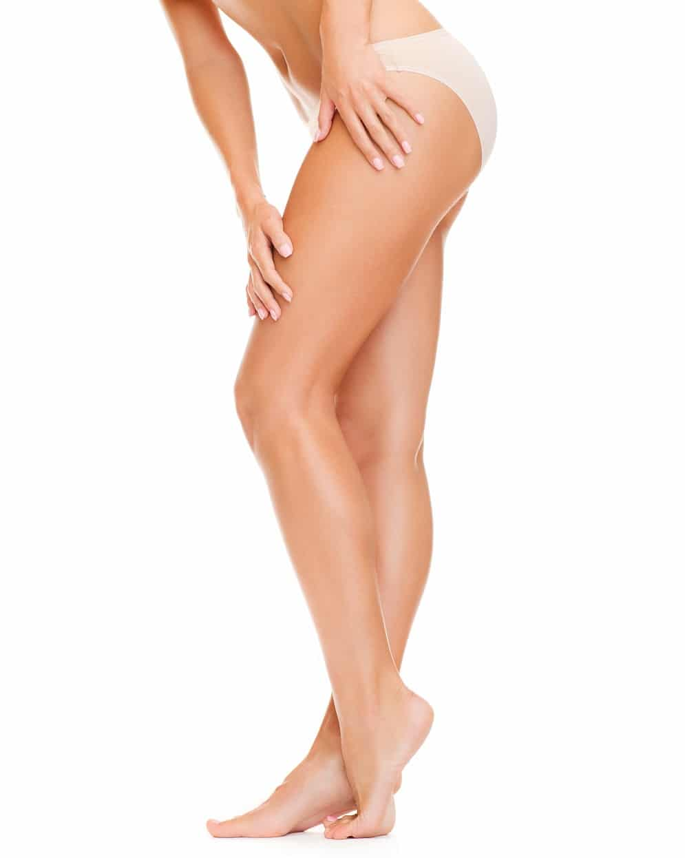 A woman with long legs in cotton underwear