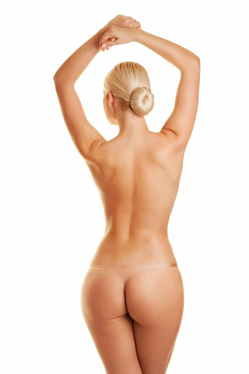 A Woman without cellulite showing her back, butt and legs