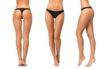 Perfect female legs and bottoms without any cellulite in black bikini panties