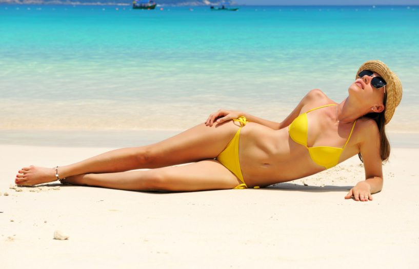 A slim woman on the beach