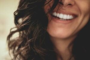 a woman with white teeth